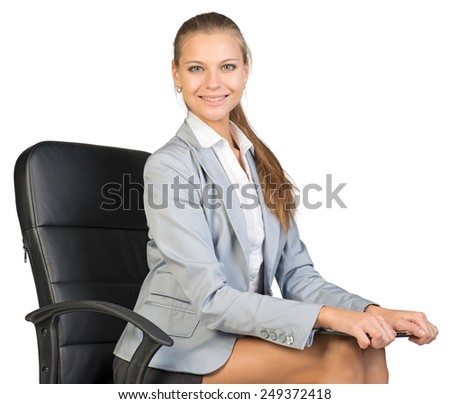 Businesswoman sitting on office chair holding clipboard on her knees, looking at camera, smiling. Isolated over white background - stock photo