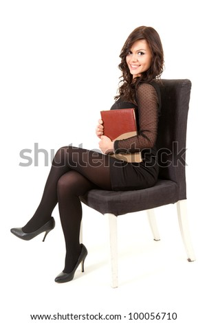 businesswoman sitting on the chair and keeping book, full length, white background