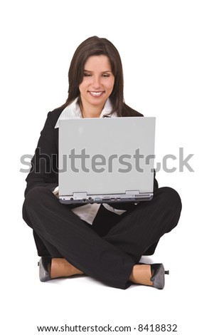 Businesswoman sitting with a laptop in her lap
