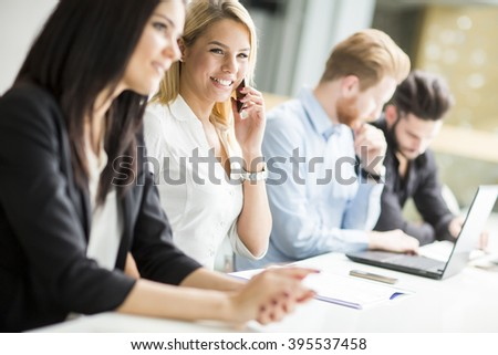 Businesswoman sitting with her colleagues in the office