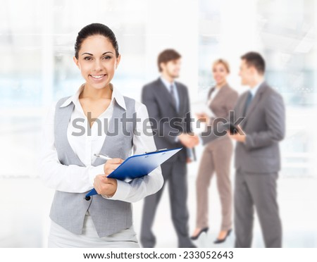 Businesswoman smile, hold blue folder clipboard paper document smile in modern bright office, business woman with colleague on background