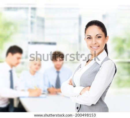 businesswoman smile in modern bright office, business woman with colleague on background