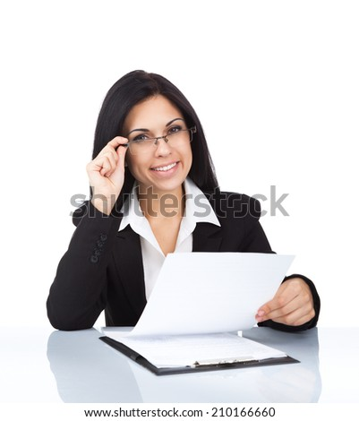 Businesswoman smile sitting at desk, wear eye glasses, young attractive business woman reading document isolated over white background - stock photo