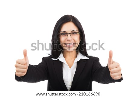 Businesswoman smile thumb up gesture, eye glasses, young attractive business woman wear black suit isolated over white background - stock photo