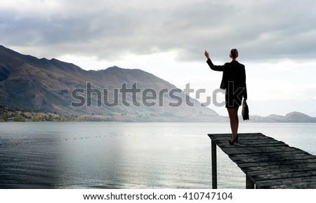 Businesswoman stand on berth - stock photo