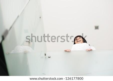 Businesswoman standing alone - stock photo