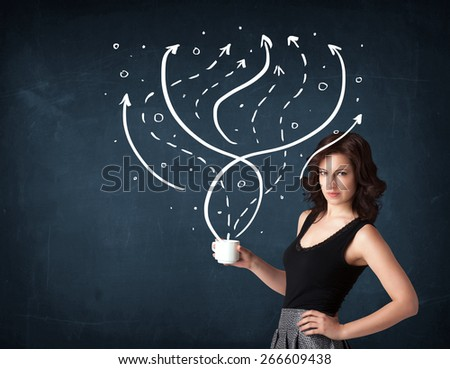 Businesswoman standing and holding a white cup with drawn lines and arrows coming out of the cup  - stock photo