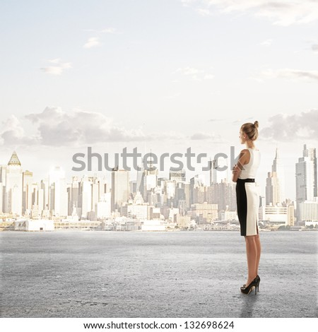 businesswoman standing and looking on city - stock photo