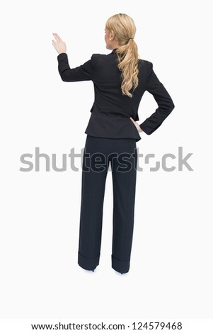 Businesswoman standing and pointing out something while being reversed - stock photo