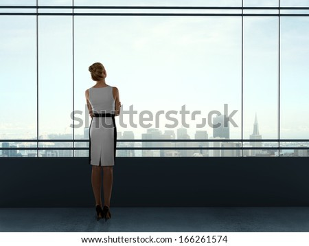 businesswoman standing and thinking in office - stock photo