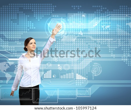 Businesswoman standing and working wth touch screen technology - stock photo