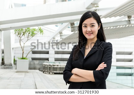 Businesswoman standing at outdoor - stock photo