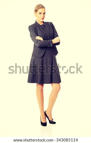 Businesswoman standing in confident pose. - stock photo