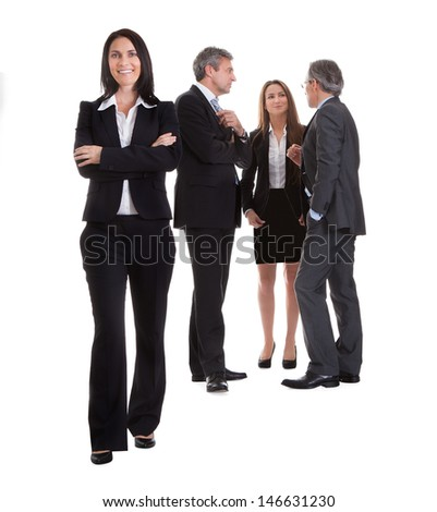 Businesswoman Standing In Front Of Her Colleagues Over White Background - stock photo