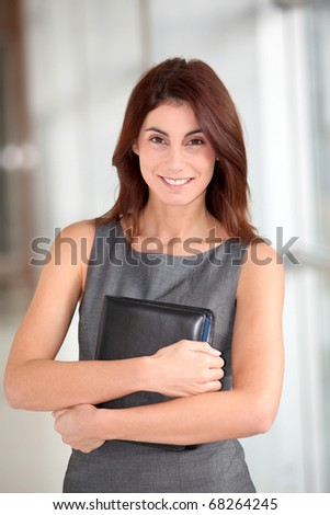 Businesswoman standing in hall with agenda