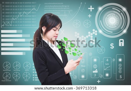 Businesswoman standing in the way businesses handle phone to communicate,Graph icon behind - stock photo