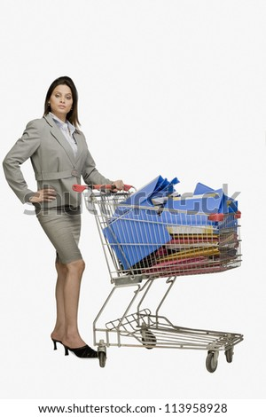 Businesswoman standing near a shopping cart filled with files