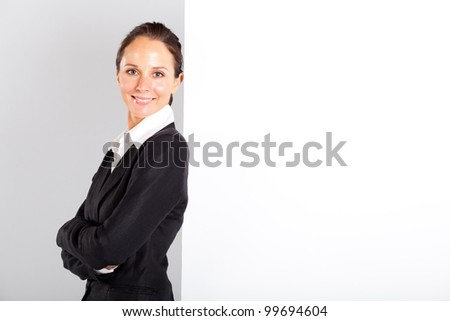 businesswoman standing next to white board - stock photo