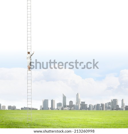 Businesswoman standing on ladder high above city - stock photo