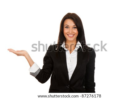 Businesswoman standing smiling holding her hand showing something on the open palm, concept of advertisement product, empty copy space, isolated over white background