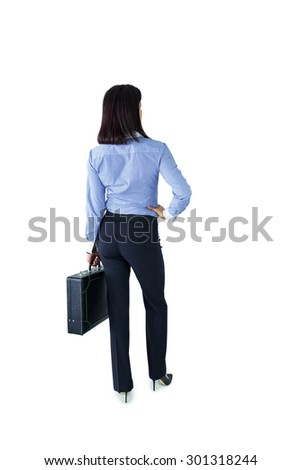 Businesswoman standing with her briefcase on white background - stock photo
