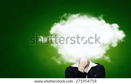 Businesswoman standing with his head in cloud - stock photo