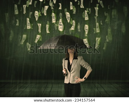 Businesswoman standing with umbrella in dollar bill rain concept on background - stock photo