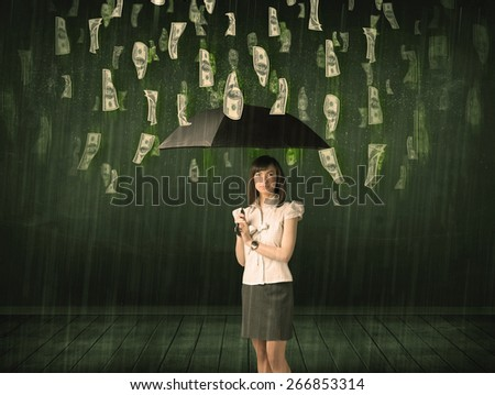 Businesswoman standing with umbrella in dollar bill rain concept on background