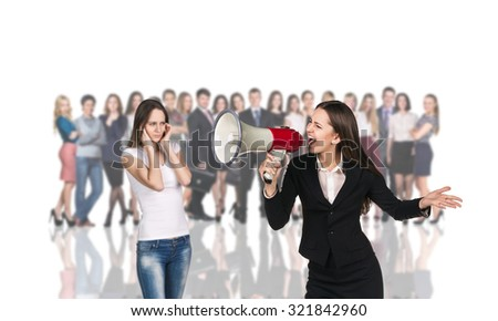Businesswoman stands foreground on the blurred people and white background - stock photo