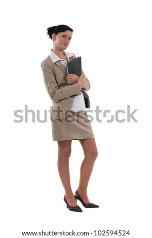 Businesswoman stood holding clip-board