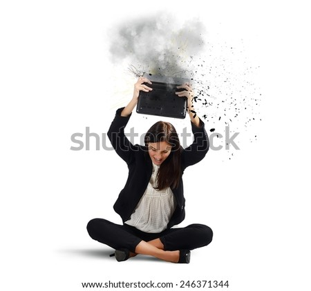 Businesswoman stressed from work breaks her laptop - stock photo