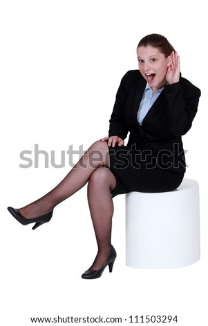 Businesswoman struggling to hear - stock photo
