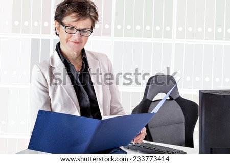 Businesswoman studied business papers