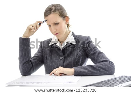 Businesswoman studying documents at white office desk. - stock photo