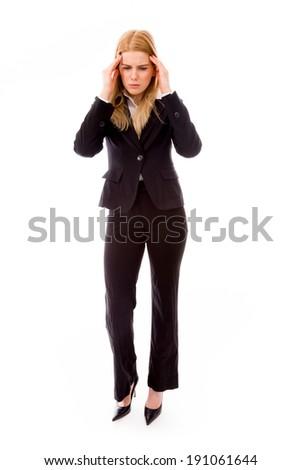 Businesswoman suffering from headache - stock photo