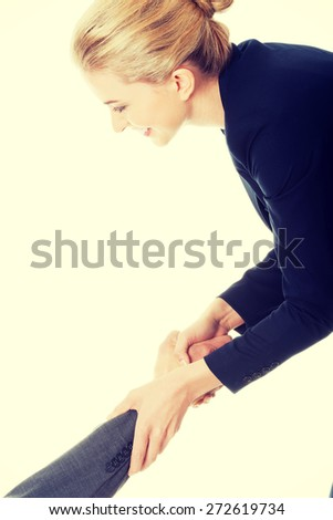 Businesswoman supporting her office partner - stock photo
