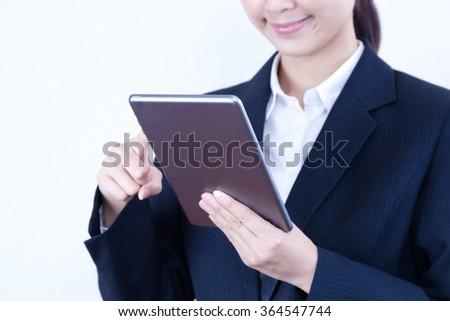 Businesswoman tablet swipe Internet - stock photo