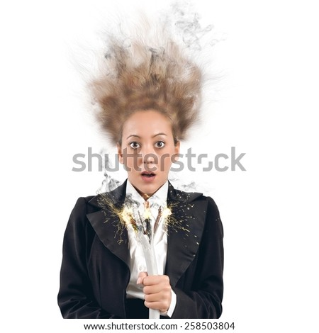 Businesswoman takes the shock with a cable - stock photo