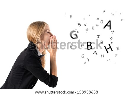 businesswoman talking and letters coming out of her mouth  - stock photo