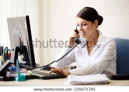 Businesswoman talking by phone - stock photo