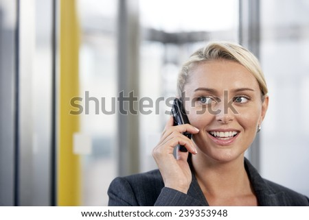 Businesswoman Talking on a Cell Phone - stock photo