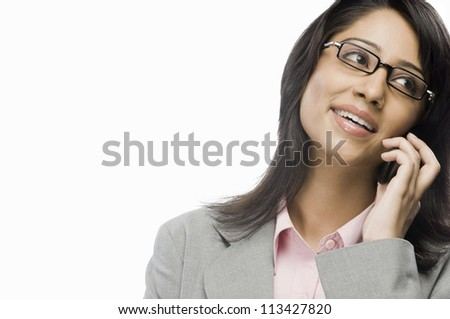 Businesswoman talking on a mobile phone - stock photo