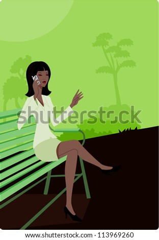 Businesswoman talking on her cell phone while sitting on a park bench - stock photo
