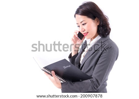 Businesswoman talking on mobile phone - stock photo