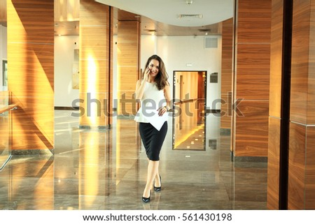 Businesswoman talking on the mobile phone in office