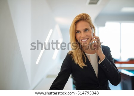 Businesswoman talking on the phone in the office.
