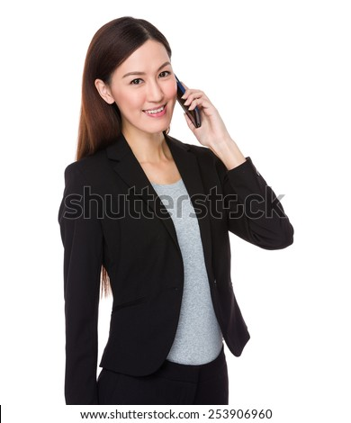 Businesswoman talks on mobile phone