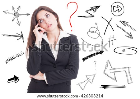 Businesswoman thinking about a problem and looking for solution with many arrows and question mark behind her - stock photo
