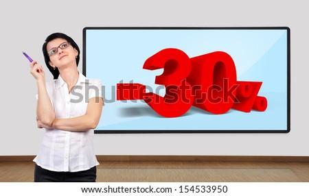 businesswoman thinking and big plasma on wall - stock photo