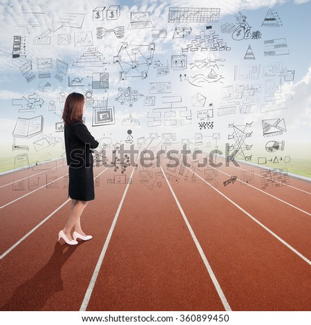 Businesswoman thinking  with business plan concept on the air and standing in Running track with sky cloud - stock photo
